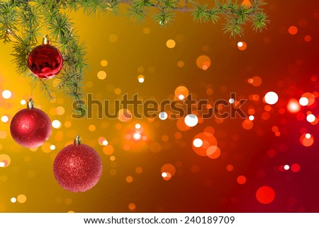 Christmas red balls with green fir tree on colorful bokeh background. New Year greeting card. Xmas Decorations. Sparkles and bokeh. Shiny and glowing copyspace, place for text and advert. - stock photo