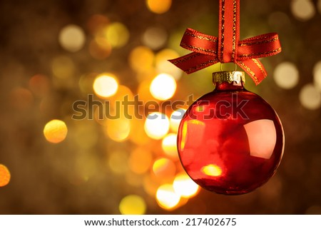 Christmas red bauble and bow  over magic bokeh  background  - stock photo