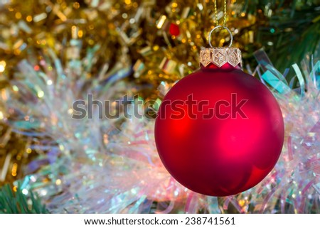 Christmas red bauble with tinsel  - stock photo