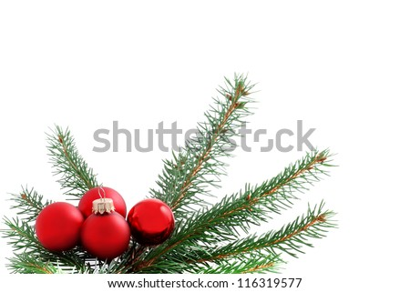 Christmas red baubles and green branches, holiday background