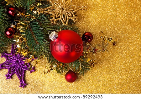 christmas red baubles with snowflakes on a golden shiny background