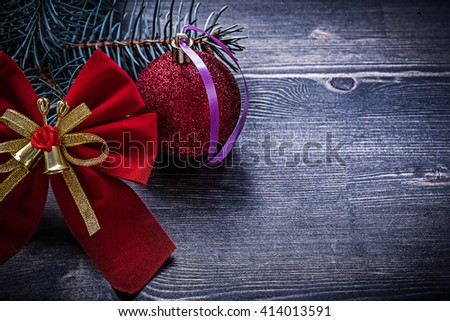 Christmas red bow bauble evergreen pine branch holidays concept. - stock photo