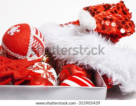 christmas red decoration isolated , white background for post card greetings, toy design in box santas red hat - stock photo