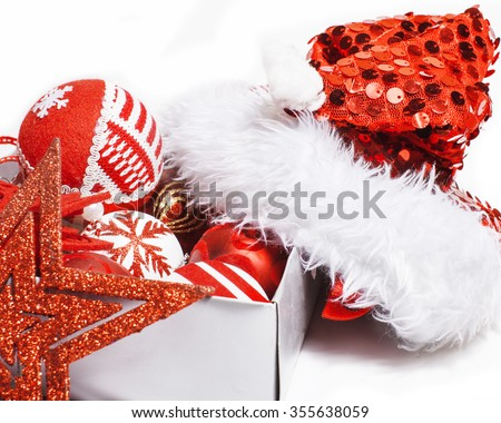 christmas red decoration isolated , white background for post card greetings, toy design in box santas red hat close up - stock photo