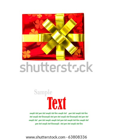 Christmas red gift box tied with gold ribbon bow on white background. - stock photo