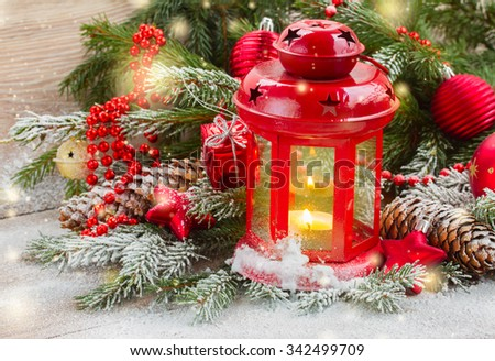 christmas red glowing lantern  with evergreen  tree and sparkles - stock photo