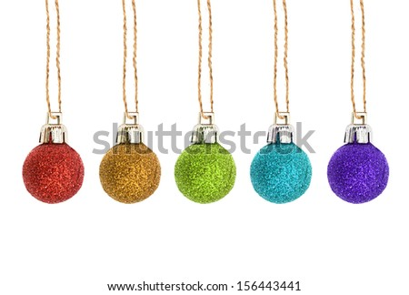 Christmas red, yellow, green, blue sphere on a rough rope - stock photo
