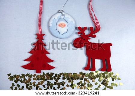 Christmas. Reindeer and Christmas tree isolate on white - stock photo