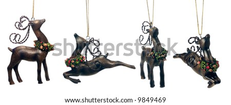 Christmas reindeer ornaments isolated over a white background - stock photo