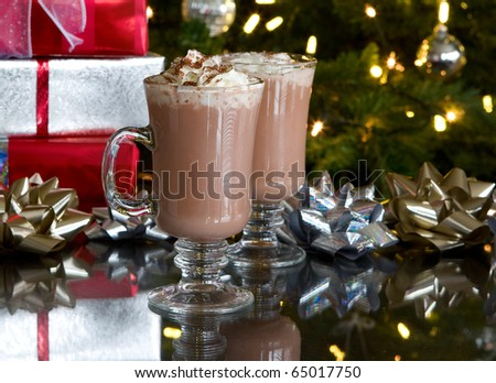 christmas relaxation: two cups of hot chocolate and whipped cream with holiday background - stock photo