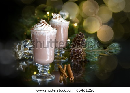 christmas relaxation: two cups of hot chocolate and whipped cream with holiday background