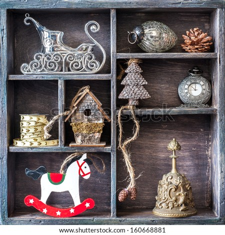 Christmas retro collage with toys and decorations. Antique clocks, bell, rocking horse, Santa's sleigh. - stock photo