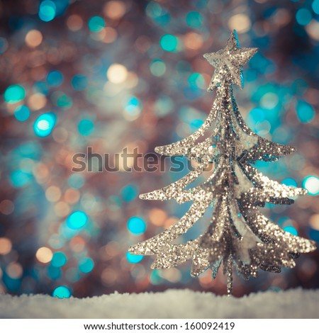 Christmas retro tree toy over defocused background - stock photo