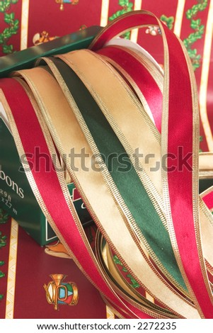Christmas ribbons with gift wrapping paper - stock photo