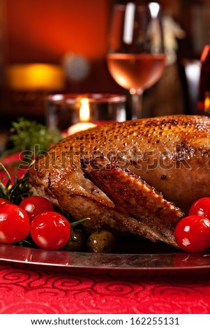 Christmas roast duck served on a festive table
