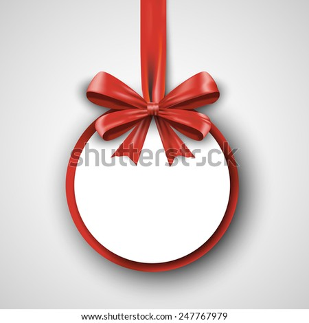 Christmas round gift card with red ribbon and satin bow.