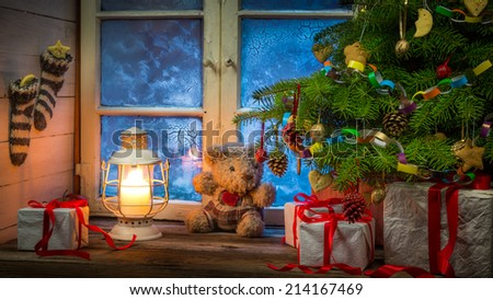 Christmas rural cottage in frosty evening - stock photo