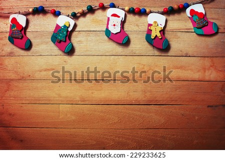 Christmas rustic background - vintage planked wood with christmas decorations  and free text space - stock photo