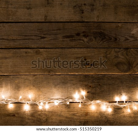 Christmas rustic background - vintage planked wood with lights and free text space