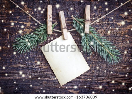 Christmas rustic decoration on textured wooden background - stock photo