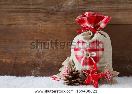 christmas sack before wooden board - stock photo