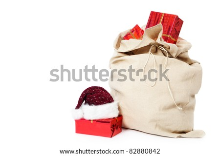 christmas sack full of gifts isolated on white - stock photo