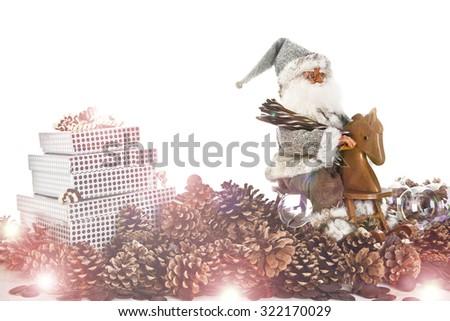 christmas sale cocept,vintage,greeting card, bright sun light ,santa claus on horse,children toy,chocolate present box - stock photo