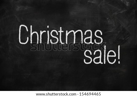 Christmas Sale handwritten with white chalk on a blackboard