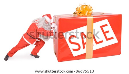 Christmas sale. Santa Claus with Christmas box isolated on white background. Santa pushing big Xmas package with sign Sale. Great Christmas gift from sale.