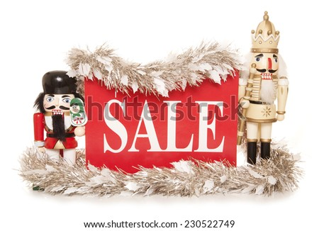 christmas sale sign with nutcracker ornaments cutout - stock photo