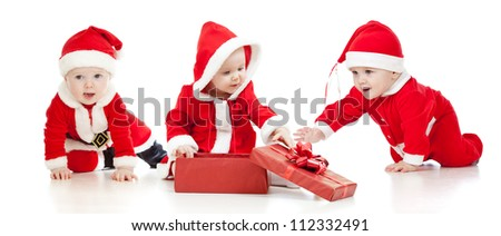 christmas Santa Claus babies boys and girl with gift box - stock photo