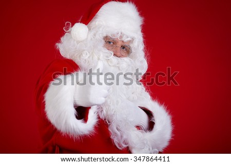 Christmas Santa Claus portrait over red background