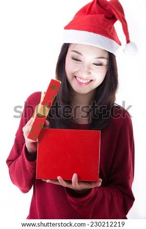 Christmas Santa girl open gift box with happy smile with white background - stock photo