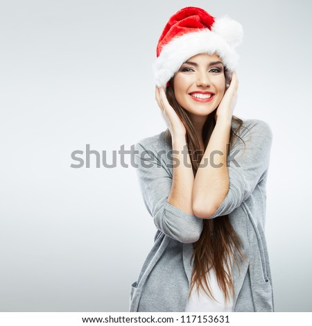 Christmas Santa hat isolated woman portrait . Smiling happy girl on white background. - stock photo