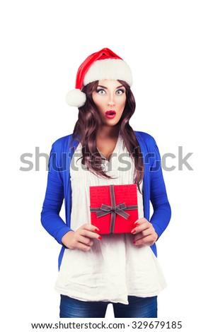 Christmas Santa hat woman portrait hold christmas gift - stock photo