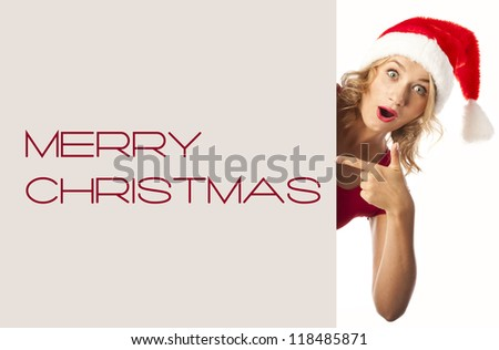 Christmas Santa woman is showing blank empty billboard. sale - stock photo