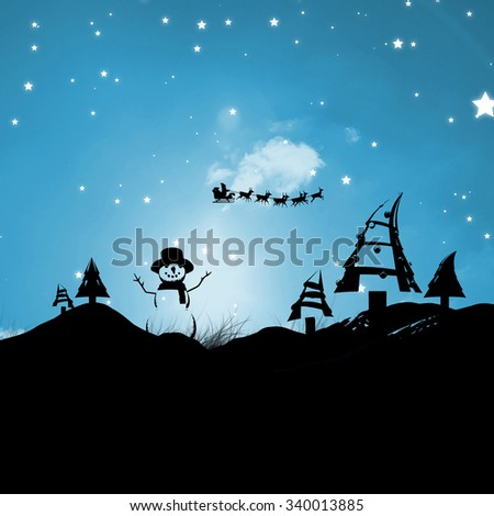 Christmas scene silhouette against blue sky over grass