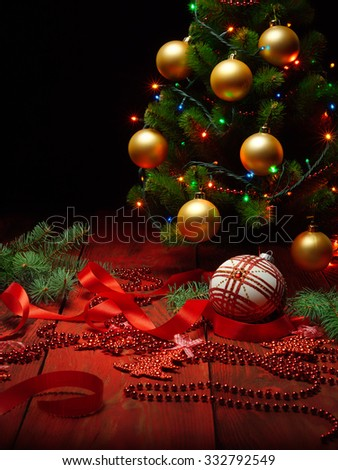 Christmas scene with Christmas tree and balls on black background - stock photo