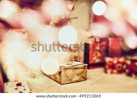 Christmas scene with gifts and festive bokeh , blurred holiday background