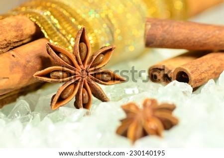 christmas season, cinnamon sticks, anise stars - stock photo