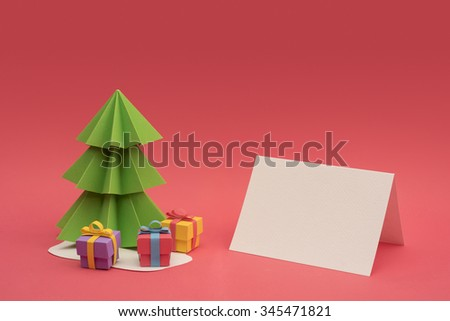 Christmas season paper cut design: 3d handmade xmas pine tree, gift boxes and empty greeting card template with clipping path. Ideal for holiday project. - stock photo