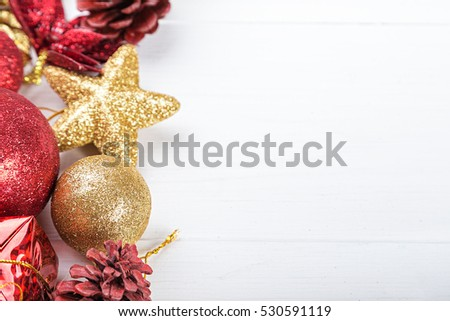 Christmas set, Christmas toys space for text on the greeting card. gold and red toy.