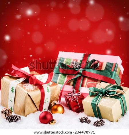 Christmas setting with colorful presents over red background  - stock photo