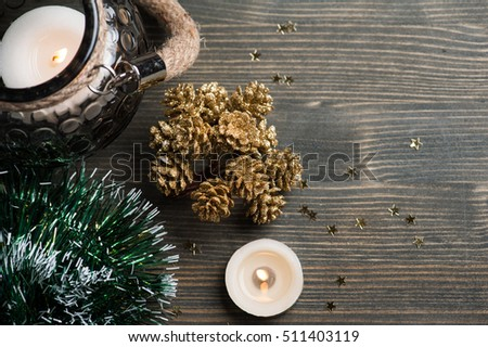 Christmas setting with golden pines, lit candles and stars. Xmas holidays background with copyspace