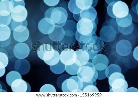 Christmas shiny light bokeh in  blue colors - stock photo