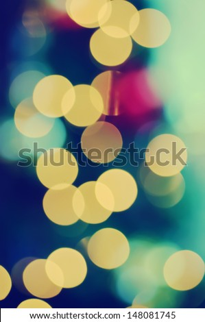 Christmas shiny light bokeh in  blue, green  and yellow colors, vintage retro hipster background - stock photo