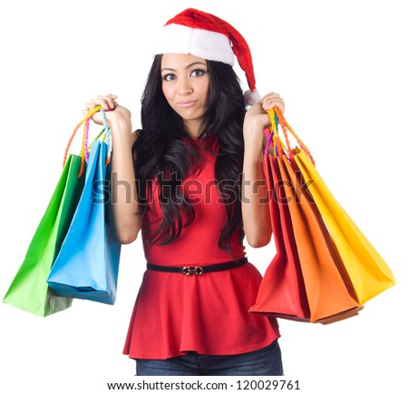 Christmas Shopping, Asian woman holding colorful shopping bags wearing santa hat on white background