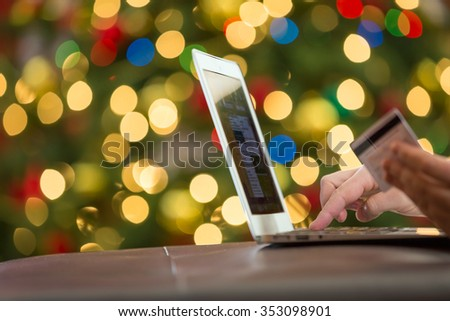 Christmas shopping using laptop - stock photo