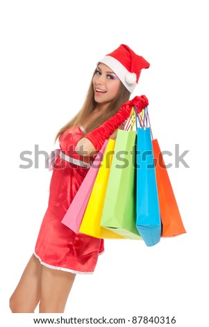 Christmas shopping woman, Happy excited santa girl holding colorful bag isolated on white background