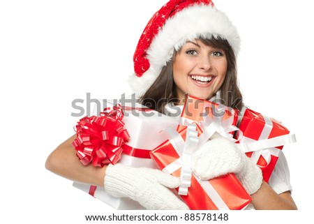 Christmas shopping woman holding gifts wearing red Santa hat. - stock photo